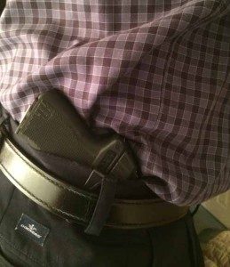 One of the author's PF-11s with the clip installed, and carried via the clip inside his waistband.