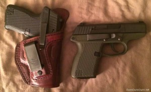 Two of the author's PF-11s. Both have the carry clip installed, and one is in an Alessi Talon IWB holster.