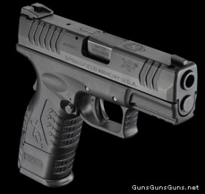 Springfield Armory XD(M) Compact right plus mag photo