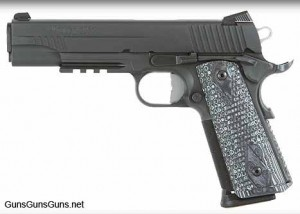 The 1911 Extreme from the left.
