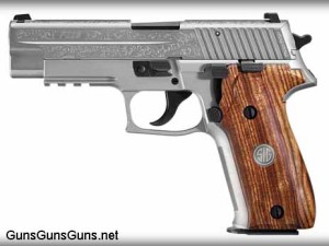 The P226 Engraved stainless model, from the left.
