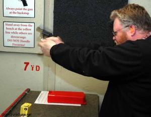 Murphy shooting the gun photo